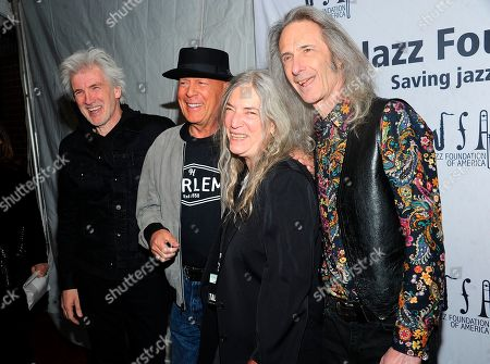 """Stock Photo of Tony Shanahan; Patti Smith;Lenny Kaye; Bruce Willis. Tony Shanahan, Left,Bruce Willis, second left Patti Smith, center and Lenny Kaye walk the red carpet at the Jazz Foundation of America's 17th annual """"A Great Night In Harlem"""" gala concert at The Apollo Theater, in New York"""