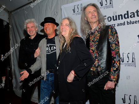 """Stock Picture of Tony Shanahan; Patti Smith;Lenny Kaye; Bruce Willis. Tony Shanahan, Left,Bruce Willis, second left Patti Smith, center and Lenny Kaye walk the red carpet at the Jazz Foundation of America's 17th annual """"A Great Night In Harlem"""" gala concert at The Apollo Theater, in New York"""