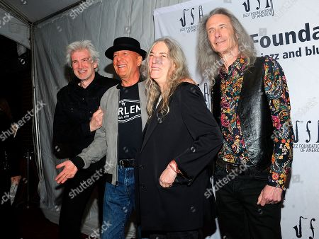 """Tony Shanahan; Patti Smith;Lenny Kaye; Bruce Willis. Tony Shanahan, Left,Bruce Willis, second left Patti Smith, center and Lenny Kaye walk the red carpet at the Jazz Foundation of America's 17th annual """"A Great Night In Harlem"""" gala concert at The Apollo Theater, in New York"""