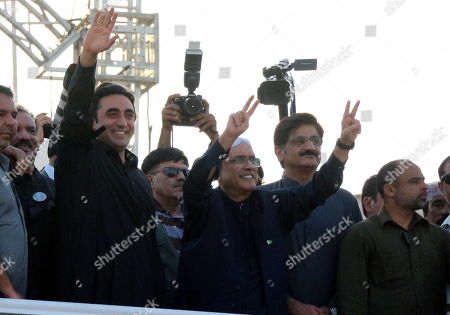 Asif Zardari (C, right), former President and co-Chairman of opposition party Pakistan People Party (PPP) and Bilawal Bhutto Zardari (C, left), his son and chairman of PPP, wave to supporters as they visit mausoleum of party's founder and former Prime Minister Zulfiqar Ali Bhutto to mark 40th death anniversary in Gari Khuda Buksh, near Larkana, Pakistan, 04 April 2019 (issued 05 April 2019). PPP founder Zulfiqar Ali Bhutto was hung by the order of military general Ziaul Haq on 04 April 1979.