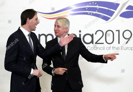 Netherlands' Minister of Finance, Wopke Hoekstra (L), is welcomed by Romanian Finance Minister Eugen Orlando Teodorovici (R) at Informal reunion of the EU Finance ministers from the Euro Area (EUROGROUP) held at Parliament Palace in Bucharest, Romania, 05 April 2019.