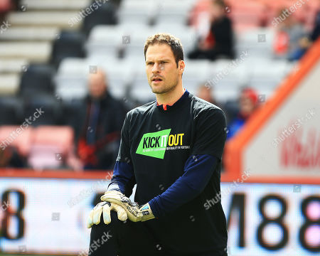Asmir Begovic of Bournemouth warms up with a Kick it out