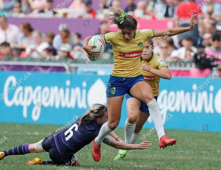 Bianca Dos Santos Silva, Chloe Rollie. Brazil's Bianca Dos Santos Silva, right, leaps from Scotland's Chloe Rollie during the final match at the World Rugby Women's Sevens Series Qualifier 2019 tournament in Hong Kong, . Brazil won 28-19