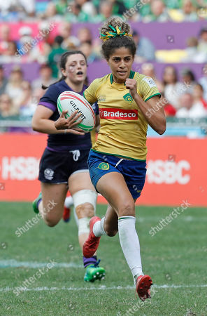 Brazil's Bianca Dos Santos Silva, runs for a try during the final match against Scotland at the World Rugby Women's Sevens Series Qualifier 2019 tournament in Hong Kong, . Brazil won 28-19