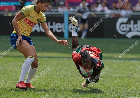 Kenya's Janet Okelo, right, scores next to Brazil's Bianca Dos Santos Silva during the semifinal match at the World Rugby Women's Sevens Series Qualifier 2019 tournament in Hong Kong, . Brazil won 17-5