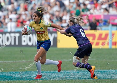 Stock Picture of Bianca Dos Santos Silva, Chloe Rollie. Brazil's Bianca Dos Santos Silva, left, is grabbed by Scotland's Chloe Rollie during the final match at the World Rugby Women's Sevens Series Qualifier 2019 tournament in Hong Kong, . Brazil won 28-19