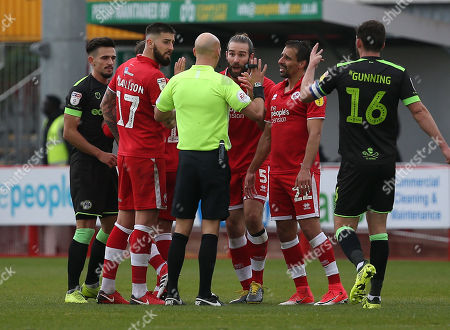 Stock Image of Crawley's Joe McNerney remonstrates with referee Darren Drysdale during the EFL 2 match between Crawley Town and Forest Green Rovers at the Peoples Pension Stadium in Crawley. 06 April 2019