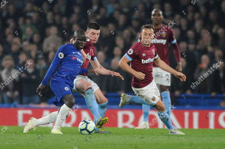 Stock Photo of NÕGolo Kante of Chelsea and Declan Rice of West Ham in action during the Premier League match between Chelsea and West Ham at Stamford Bridge in London, UK - 8th April 2019