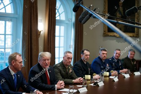 US President Donald Trump (L-2), with Acting Secretary of Defense Patrick Shanahan (L) and Chairman of the Joint Chiefs of Staff General Joseph Dunford (L-3), delivers remarks during a briefing by senior military leaders in the Cabinet Room of the White House in Washington, DC