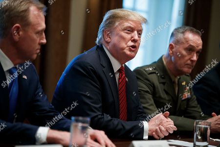 US President Donald Trump (C), with Acting Secretary of Defense Patrick Shanahan (L) and Chairman of the Joint Chiefs of Staff General Joseph Dunford (R), delivers remarks during a briefing by senior military leaders in the Cabinet Room of the White House in Washington, DC