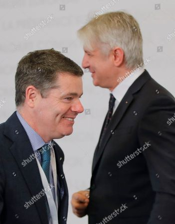 Irish Finance Minister Paschal Donohoe, left, walks by Romanian counterpart Eugen Teodorovici upon arriving at the informal meeting of European Union Economic Financial Affairs in Bucharest, Romania