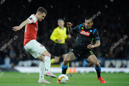 Aaron Ramsey of Arsenal and Allan of Societa Sportiva Calcio Napoli in action during the UEFA Europa League quarter final first leg match between Arsenal and Societa Sportiva Calcio Napoli at the Emirates Stadium in London, UK - 11th April 2019