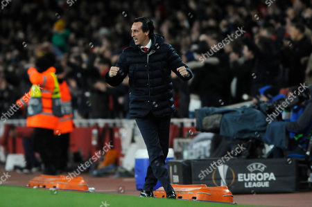 Stock Photo of Unai Emery celebrates as Aaron Ramsey of Arsenal scores the opening goal during the UEFA Europa League quarter final first leg match between Arsenal and Societa Sportiva Calcio Napoli at the Emirates Stadium in London, UK - 11th April 2019