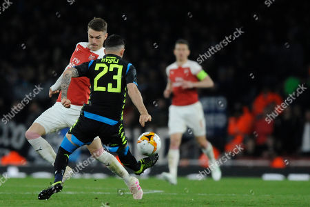 Stock Image of Aaron Ramsey of Arsenal and Elseid Hysaj of Societa Sportiva Calcio Napoli in action during the UEFA Europa League quarter final first leg match between Arsenal and Societa Sportiva Calcio Napoli at the Emirates Stadium in London, UK - 11th April 2019