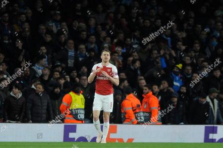 Aaron Ramsey of Arsenal celebrates scoring the opening goal during the UEFA Europa League quarter final first leg match between Arsenal and Societa Sportiva Calcio Napoli at the Emirates Stadium in London, UK - 11th April 2019