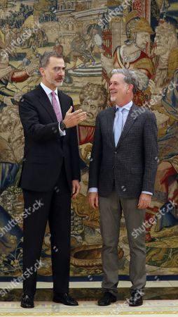 Spain's King Felipe VI (L) welcomes the Executive Director and co-founder of Netflix, Reed Hastings (R) during a royal audience at the Palace of la Zarzuela in Madrid, Spain, 05 April 2019.
