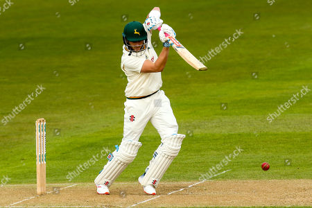 Joe Clarke of Nottinghamshire brings up his half century with a back foot cover drive
