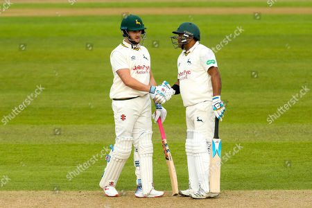 Joe Clarke of Nottinghamshire is congratulated by Samit Patel of Nottinghamshire after reaching a half century against Yorkshire