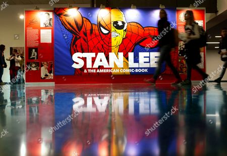 Visitors walk past a banner dedicated to US famous comic author Stan Lee during the opening of the 37th Comic Barcelona Fair, in Barcelona, Spain, 05 April 2019. The festival runs from 05 to 07 April.