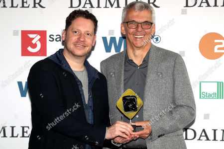 Marco Kreuzpaintner (L) and author Norbert Eberlein (R) pose with the Grimme-Preis award for 'Beat' at the 55th Grimme Award ceremony in Marl, Germany, 05 April 2019.