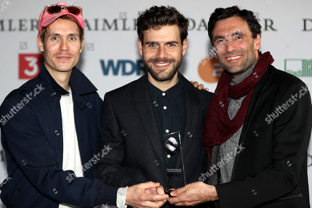 Hans Block, director Moritz Riesewieck and producer Georg Tschurtschenthaler pose with the Grimme-Preis award for 'Im Schatten der Netzwelt - The Cleaners' at the 55th Grimme Award ceremony in Marl, Germany, 05 April 2019.