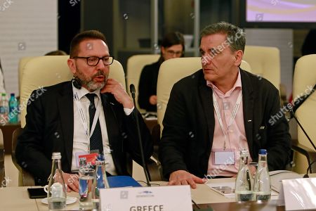 Stock Picture of Greece Finance Minister Euclid Tsakalotos (R) and Central Bank Governor Yannis Stournaras (L) attend the informal reunion of the Economic and Financial Affairs Council of the European Union (ECOFIN) held at Parliament Palace in Bucharest, Romania, 05 April 2019. Eurozone finance ministers have released long delayed debt relief of 970 million Euros to Greece, after the government had implemented reforms promised during the bailout that ended last year.