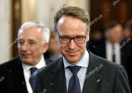 Germany's Natioal Bank President Jens Weidmann (R) smiles after passing by Mugur Isarescu (L), the governor of Romanian National Bank (R), during the Economic and Financial Committee Meeting of the EU Finance ministers and governors of the Central Banks (ECOFIN)  at Parliament Palace in Bucharest, Romania, 05 April 2019.