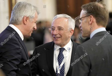 Germany's National Bank President Jens Weidmann (R) and Romanian Finance Minister Eugen Orlando Teodorovici (L) chat with Mugur Isarescu (C), the governor of Romanian National Bank during the Economic and Financial Committee Meeting of the EU Finance ministers and governors of the Central Banks (ECOFIN) at Parliament Palace in Bucharest, Romania, 05 April 2019.
