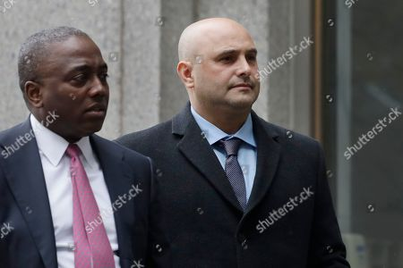 Craig Carton, right, the former co-host of a sports radio show with ex-NFL quarterback Boomer Esiason, arrives at federal court to be sentenced for defrauding investors in a ticket reselling business, in New York