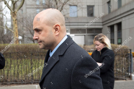 Craig Carton, the former co-host of a sports radio show with ex-NFL quarterback Boomer Esiason, leaves federal court after receiving a 3 1/2 year sentence for defrauding investors in a ticket reselling business, in New York