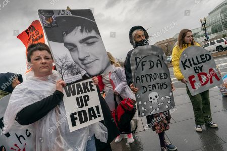 Tracy Martin of Philadelphia holds a photo of her son Aaron Starrs, who died at age 21, as she joins demonstrators protesting the Food and Drug Administration's policies related to pharmaceutical opioids at a rally in front of the Health and Human Services headquarters in Washington