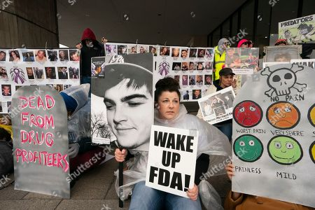 Tracy Martin of Philadelphia holds a photo of her son Aaron Starrs who died at age 21 as she joins demonstrators protesting the Food and Drug Administration's policies related to pharmaceutical opioids at a rally in front of the Health and Human Services headquarters in Washington
