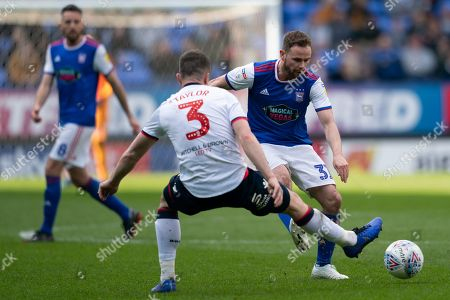 Ipswich Town Alan Judge under pressure from Bolton Wanderers Andrew Taylor