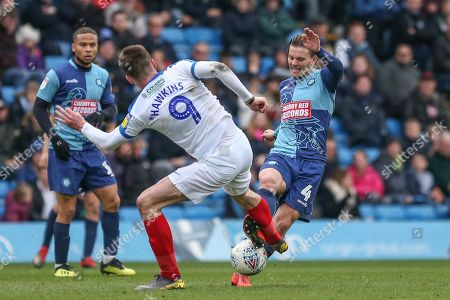 6th April 2019, Adams Park,  High Wycombe, England; Sky Bet League One, Wycombe Wanderers vs Portsmouth ; Oliver Hawkins (09) of Portsmouth pressures Dominic Gape (4) of Wycombe Wanderers.