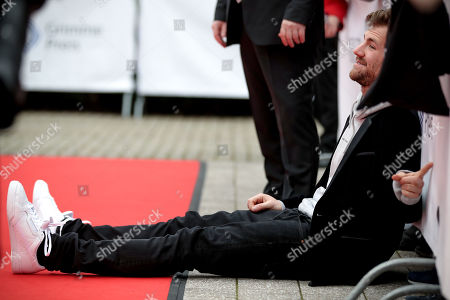 epa07487039 Italian-Canadian comedian living in Germany Luke Mockridge poses as he arrives on the red carpet of the 55th Grimme Award ceremony in Marl, Germany, 05 April 2019. The Grimme-Preis is a German television award.