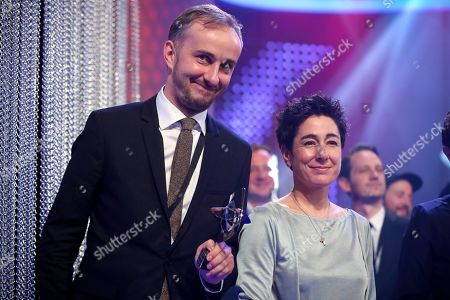 Stock Image of German satirist and television presenter Jan Boehmermann (L) and German journalist and television presenter Dunja Hayali (R) attend the 55th Grimme Award ceremony in Marl, Germany, 05 April 2019. The Grimme-Preis is a German television award.