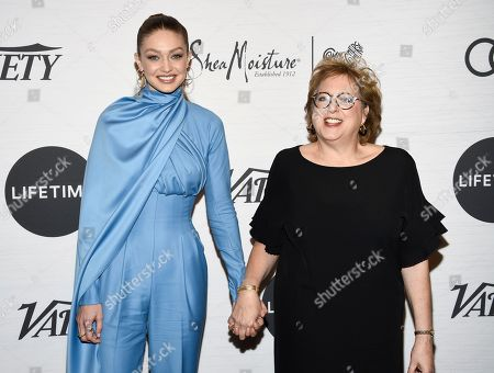 Stock Photo of Gigi Hadid, Caryl Stern. Honoree Gigi Hadid, left, and UNICEF USA CEO and president Caryl Stern pose together at Variety's Power of Women: New York presented by Lifetime at Cipriani 42nd Street, in New York