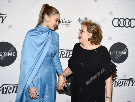 Stock Picture of Gigi Hadid, Caryl Stern. Honoree Gigi Hadid, left, and UNICEF USA CEO and president Caryl Stern pose together at Variety's Power of Women: New York presented by Lifetime at Cipriani 42nd Street, in New York