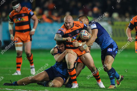 Castleford's Nathan Massey is tackled by Wigan's Oliver Partington, Liam Byrne and Thomas Leuluai.