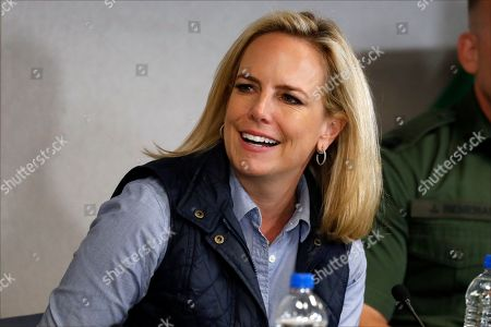 Homeland Security Secretary Kirstjen Nielsen listens to President Donald Trump at a roundtable on immigration and border security at the U.S. Border Patrol Calexico Station in Calexico, Calif., . Trump headed to the border with Mexico to make a renewed push for border security as a central campaign issue for his 2020 re-election