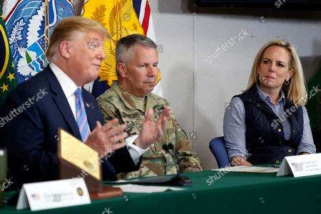 Lt. Gen. Todd Semonite, commanding General of the U.S. Army corps of Engineers, center and Homeland Security Secretary Kirstjen Nielsen, listens as President Donald Trump participates in a roundtable on immigration and border security at the U.S. Border Patrol Calexico Station in Calexico, Calif., . Trump headed to the border with Mexico to make a renewed push for border security as a central campaign issue for his 2020 re-election