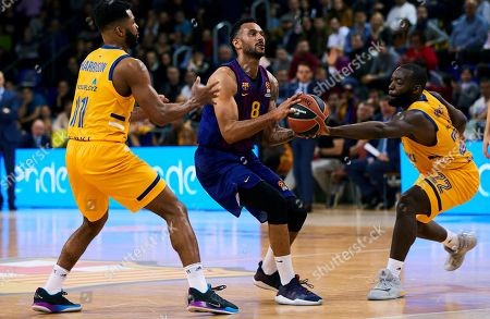 Barcelona's forward Adam Hanga (C) in action against Khimki's forward Charles Andrew Harrison (L) and guard Charles Jenkins (R) during the Euroleague match between FC Barcelona Lassa and Khimki Moscow at Palau Blaugrana pavilion in Barcelona, Catalonia, Spain, 05 April 2019.