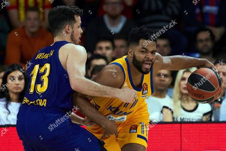 Stock Photo of Barcelona's guard Thomas Heurtel (L) in action against Khimki's guard Andrew Harrison (R) during the Euroleague match between FC Barcelona Lassa and Khimki Moscow at Palau Blaugrana pavilion in Barcelona, Catalonia, Spain, 05 April 2019.