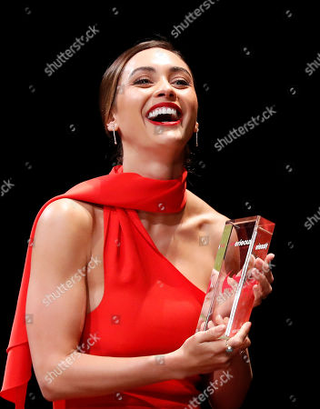 Lindsey Morgan poses with her Seriously Award on stage during the opening ceremony of the Cannes Series Festival, in Cannes, 05 April 2019. The event runs from 05 to 10 April.