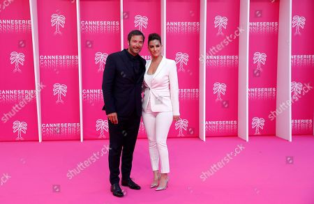 Franck Semonin (L) and his wife Helene Semonin (R) pose on the pink carpet before the opening ceremony of the Cannes Series Festival, in Cannes, 05 April 2019. The event runs from 05 to 10 April.