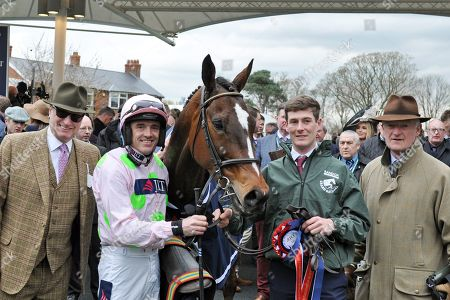 Stock Image of , Aintree, GB, Min with Ruby Walsh, owner Rich Ricci and trainer Willie Mullins (right) after winning the JLT Chase at Aintree racecourse.