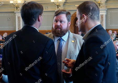 Jene Vickrey, Dan Hawkins. Kansas House Speaker Pro Tem Blaine Finch, center, confers with Rep. Fred Patton, left, R-Topeka, and B.J. Harden, the chief of staff to the House Majority Leader, during a debate, at the Statehouse in Topeka, Kan. Lawmakers have passed a bill to allow the Kansas Farm Bureau to sell health coverage to its members that doesn't comply with the federal Affordable Care Act