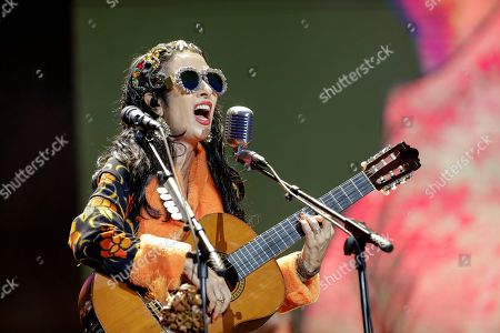 Stock Photo of Singer Marisa Monte, of the Brazilian music band Tribalistas performs during the Lollapalooza Festival, in Sao Paulo, Brazil, 05 April 2019. The festival, with performances of Sam Smith, Arctic Monkeys, Kings of Leon, Lenny Kravitz, and Twenty One Pilots among others, will last until 07 April.