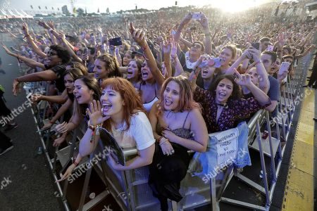 Fans attend a concert of the British rock band The 1975 during the Lollapalooza Festival, in Sao Paulo, Brazil, 05 April 2019. The festival, with performances of Sam Smith, Arctic Monkeys, Kings of Leon, Lenny Kravitz, and Twenty One Pilots among others, will last until 07 April.