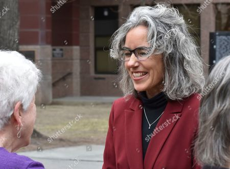 Former state Rep. Kathleen Williams, right, smiles to a supporter after announcing her candidacy for Montana's U.S. House seat at a rally in Billings, Mont., . The move comes just five months after the Democrat lost to incumbent Republican Greg Gianforte in the 2018 election. Williams served three terms in the Montana House and prevailed over five other candidates to become her party's candidate during the last election. Incumbent Republican Rep. Greg Gianforte has not yet announced if he'll seek another term
